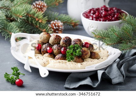 Homemade swedish meatballs with mashed potatoes and cranberry sauce, selective focus - stock photo
