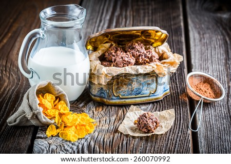 Homemade sweet chocolate balls with corn flakes and milk - stock photo
