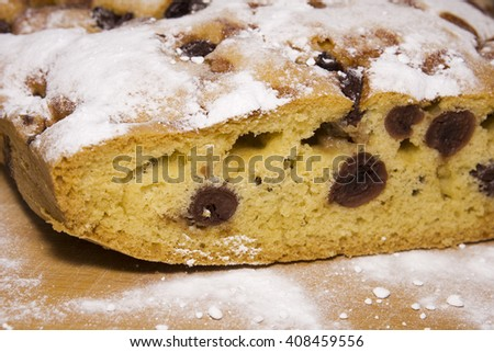 Homemade sweet Hungarian bread with prunes with sugar on a wooden surface