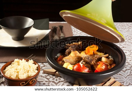 Homemade tajine dish and fresh couscous on a table - stock photo