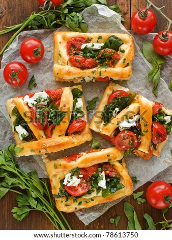 Homemade tart slices with cottage cheese, herbs and cherry tomatoes. Viewed from above. - stock photo