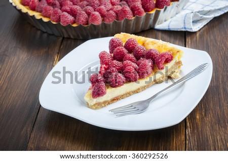 homemade tart with raspberries - stock photo