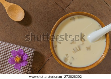 Homemade thai style soy bean milk with jelly on the rustic wooden table