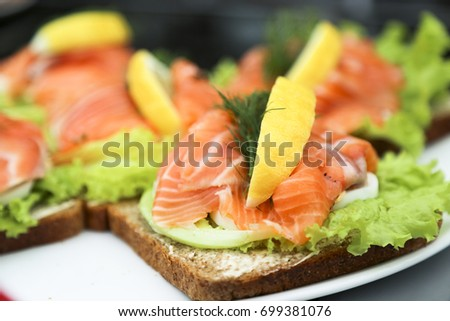 Homemade toasts with smoked salmon and avocado