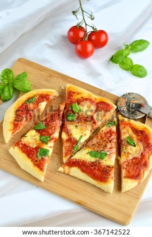Homemade tomato mozzarella basil pizza  - stock photo