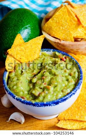 homemade traditional avocado guacamole and tortilla chips - stock photo