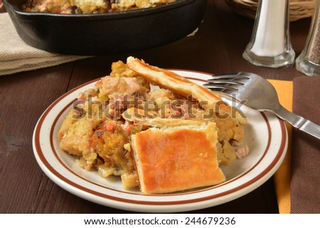 Homemade turkey pot pie with cornbread stuffing and vegetables