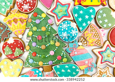 homemade various decorated christmas gingerbread cookies on white background, top view
