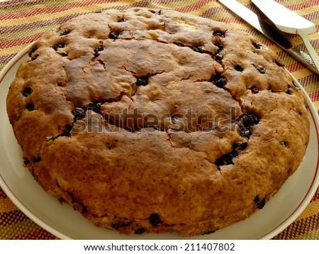 homemade vegan pie with black currant - stock photo