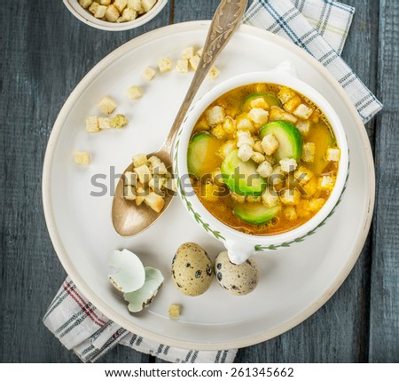 Homemade vegetable soup with brussels sprouts and croutons. Served with thyme and quail eggs. Selective focus. - stock photo