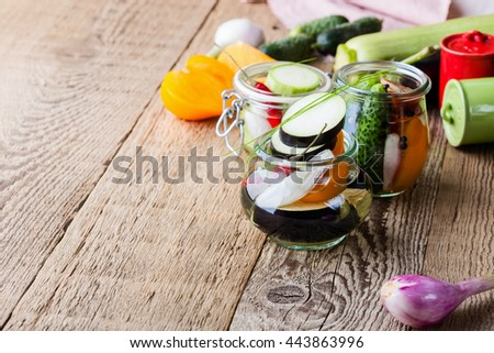 Homemade vegetables preserves. Collection set of pickled veggies in glass jars. Food concept - stock photo