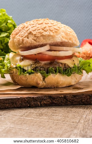 Homemade vegetarian burgers with fresh organic vegetables on rustic wooden background - stock photo