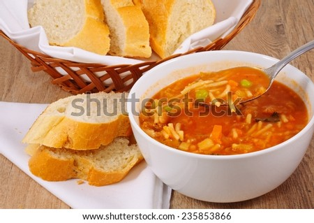 Homemade vegetarian minestrone soup served with bread.