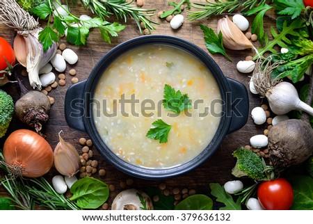 Homemade vegetarian soup, top view - stock photo