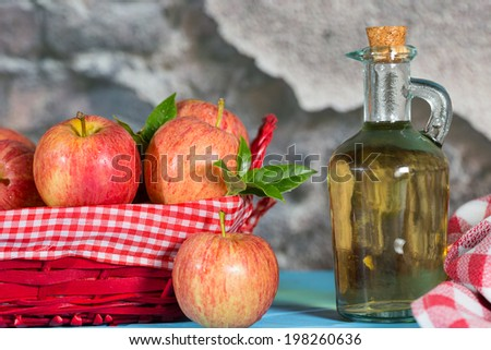 Homemade Vinegar galas apples on a table in a farmhouse - stock photo