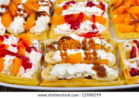 Homemade wafle with mandarin and caramel icing - stock photo