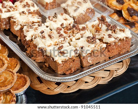 Homemade walnut carrot cake on display at the market - stock photo