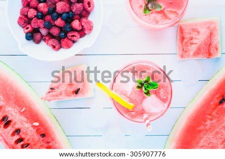 Homemade watermelon lemonade with raspberries and chokeberries - stock photo