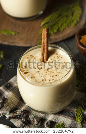 Homemade White Holiday Eggnog with a Cinnamon Stick - stock photo