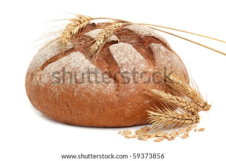 Homemade whole bread and stalks of wheat on a white background - stock photo