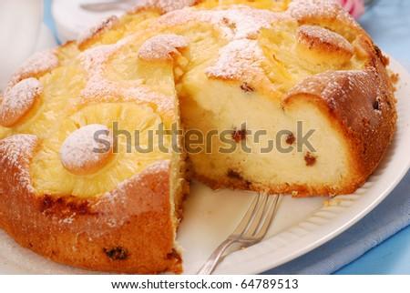 homemade yeast cake with pineapple rings and raisins - stock photo