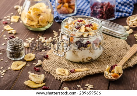 Homemade yogurt with granola, dried fruit and nuts bio - cia seed - most healthy seed, apricot and banana dried fruit - stock photo