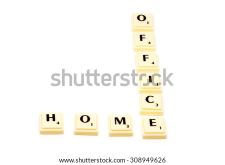 HOMEOFFICE - conceptual approach using plastic letter tiles forming the two words home and office with shadows on white background - stock photo