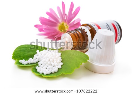 Homeopathic medication with coneflower globules. Alternative medicine concept - stock photo
