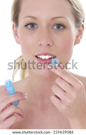 homeopathic medicine - pretty blond woman taking homeopathy - stock photo