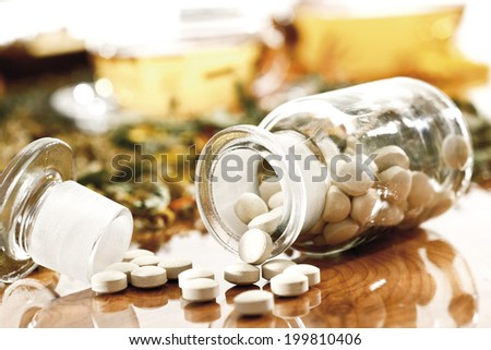Homeopathic pills in apothecary flask - stock photo