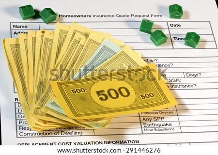 Homeowners insurance quote form with houses and money - stock photo