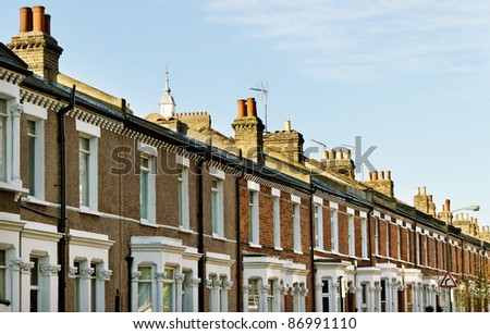 Homes in the London with chimneys. - stock photo