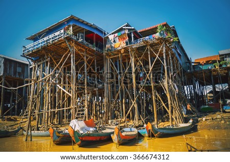 Homes on stilts on the floating village of Kampong Phluk, Tonle Sap lake, Siem Reap province, Cambodia - stock photo