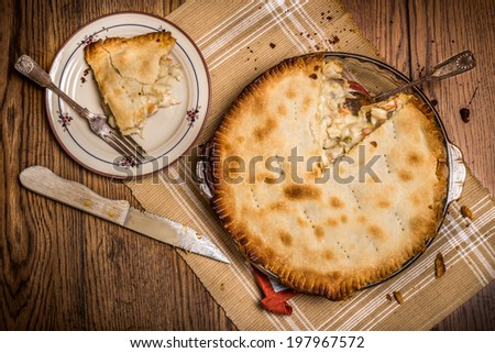 Homestyle chicken pot pie being served in rustic setting - stock photo