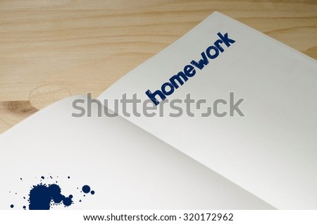 Homework written in blue on white notebook