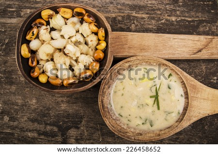 hominy and toasted corn nuts mote with tostado an aji sauce on wooden spoons ecuadorian traditional food - stock photo