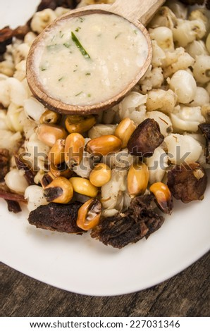 hominy and toasted corn nuts with pork skin and aji sauce  mote con chicharron traditional ecuadorian food - stock photo