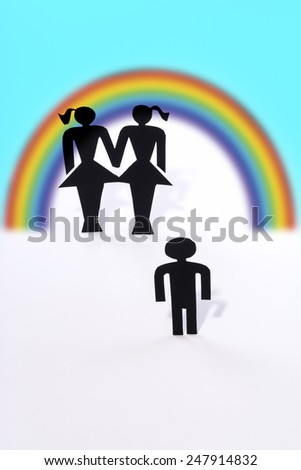 Homosexual couple with child, figurines, same-sex marriage, wish for child - stock photo