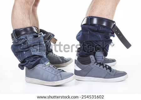 Homosexual jean at the bottom over white background on studio - stock photo
