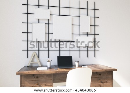 Homw office in modern house with posters on wall. Computer on brown table. Concept of work. 3D render. Mock up. - stock photo