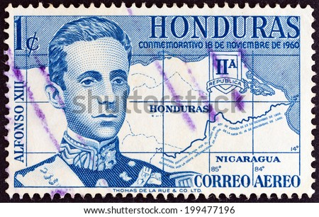 """HONDURAS - CIRCA 1961: A stamp printed in Honduras from the """"Settlement of Boundary Dispute with Nicaragua """" issue shows Alfonso XIII king of Spain and map, circa 1961.  - stock photo"""