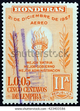 HONDURAS - CIRCA 1959: A stamp printed in Honduras issued for the 2nd Anniversary of New Constitution shows Flaming torch, circa 1959.  - stock photo