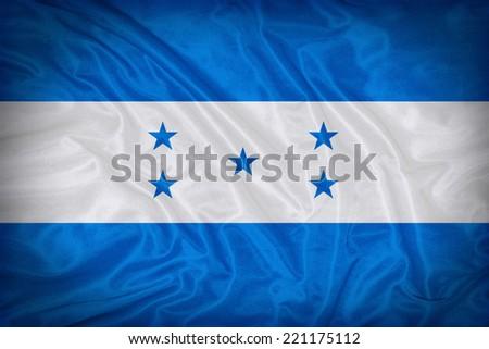 Honduras flag pattern on the fabric texture ,vintage style - stock photo