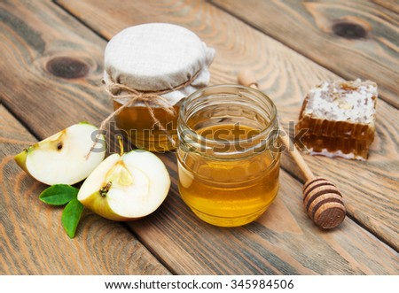 honey and apple on a old wooden background