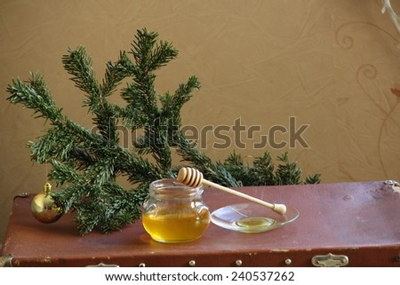 Honey and fur-tree branch with a gold sphere