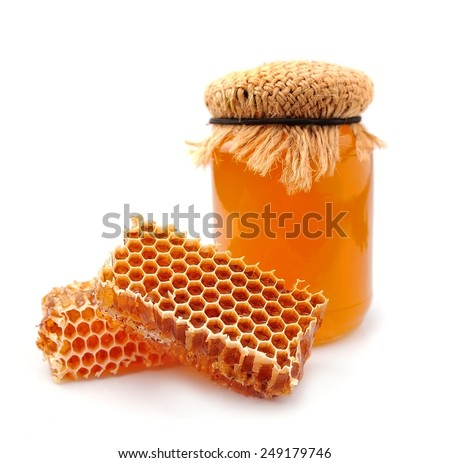 Honey and honeycomb closeup on a white background  - stock photo
