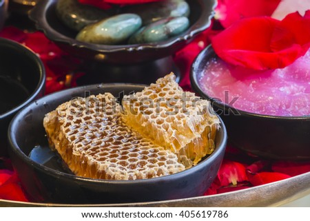 honey and spa treatment - beauty treatment. (fresh honey in comb) - stock photo