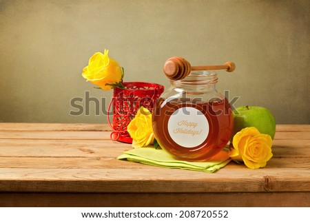 Honey, apple and flowers on wooden table. Jewish New Year celebration. - stock photo