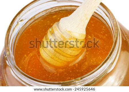 Honey background with wooden dipper - stock photo