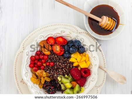 Honey black quinoa with fruits,berries and nut for breakfast - stock photo